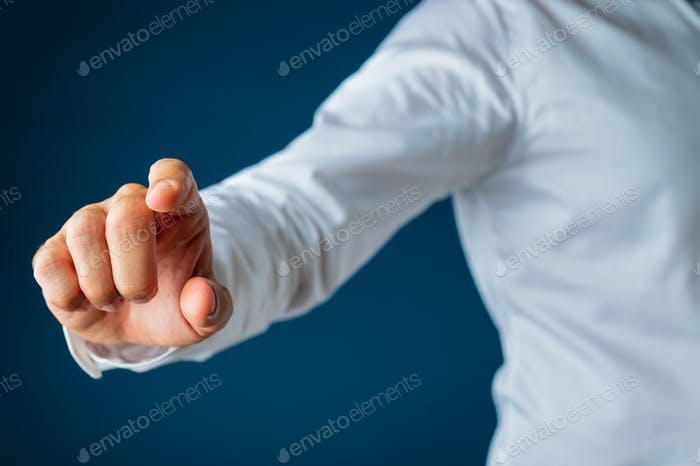 Hand of a businessman touching virtual interface screen