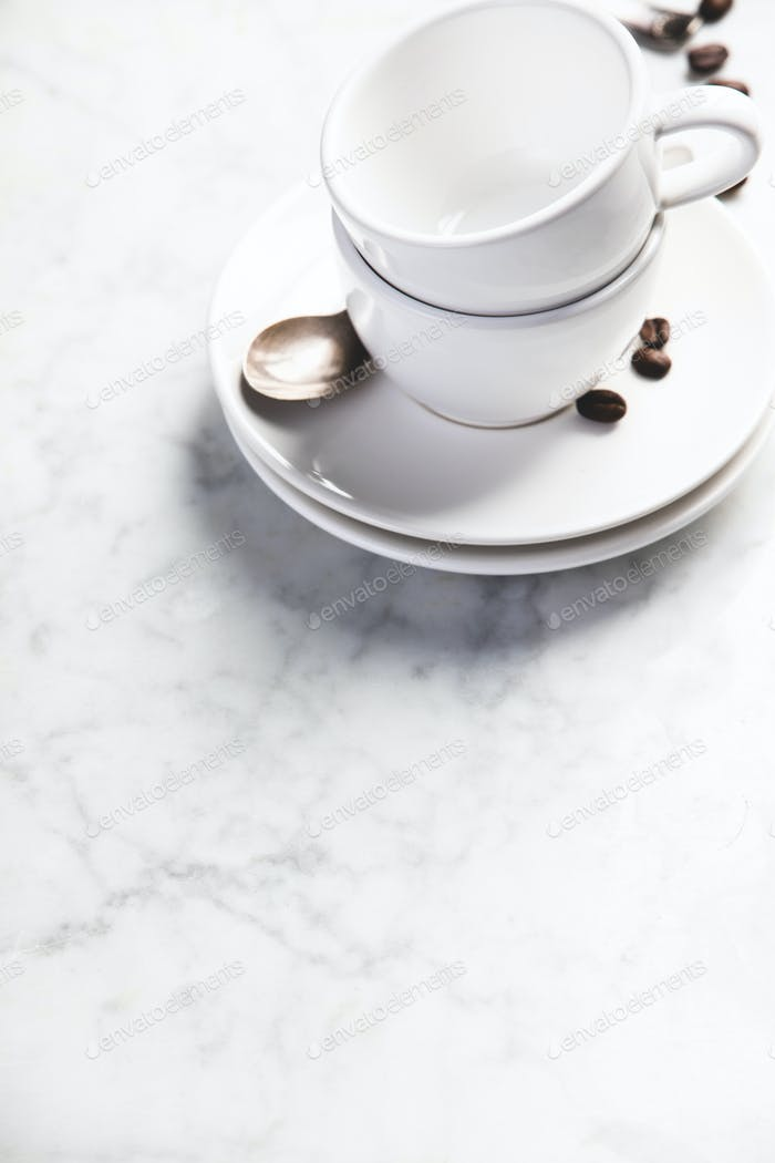 Coffee composition on white marble background, copyspace