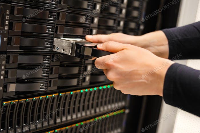 Male IT Technician Replacing Server Drive In San