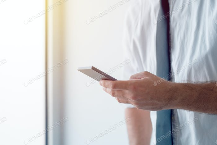 Businessman texting in free time