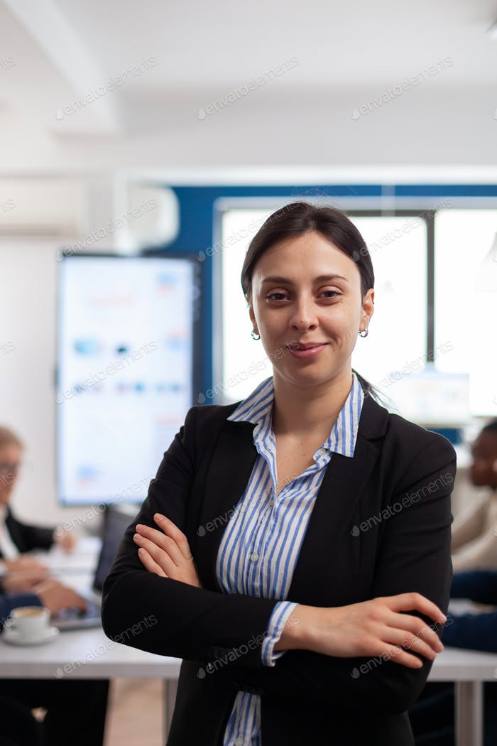 Woman entrepreneur smiling at camera standing in conference room