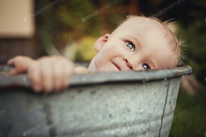 Little boy bathing outside