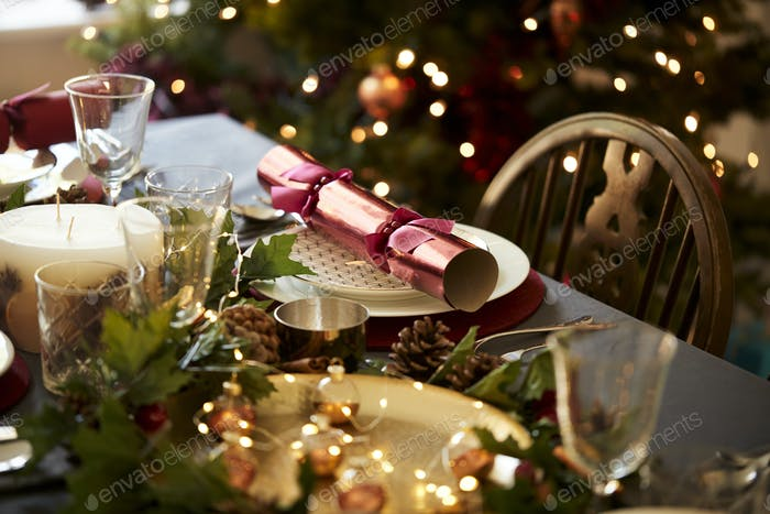 Christmas table setting with a Christmas cracker arranged on a plate