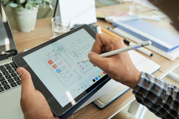 UI Designer Drawing Sketch of Mobile App