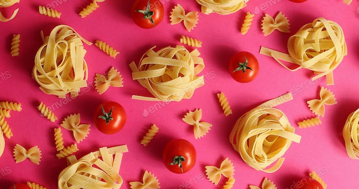 Layout of pasta and red tomatoes