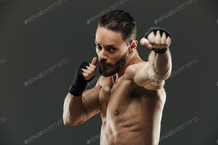 Portrait of a focused muscular sportsman boxing