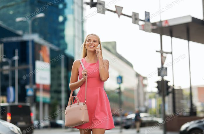 happy smiling woman calling on smartphone in city