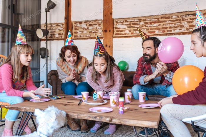 Happy family celebrating little girl birthday