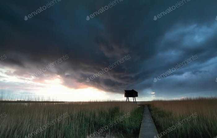 dark stormy sky over Wadden sea coast