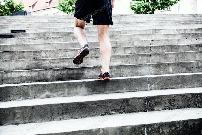 Man running on stairs, training