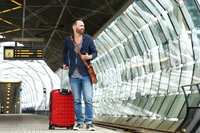 Caucasian man waiting at train station platform