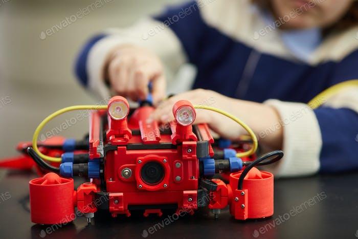 Boy Building Robot Close Up