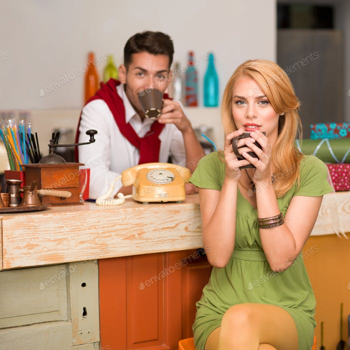 beautiful couple drinking coffee