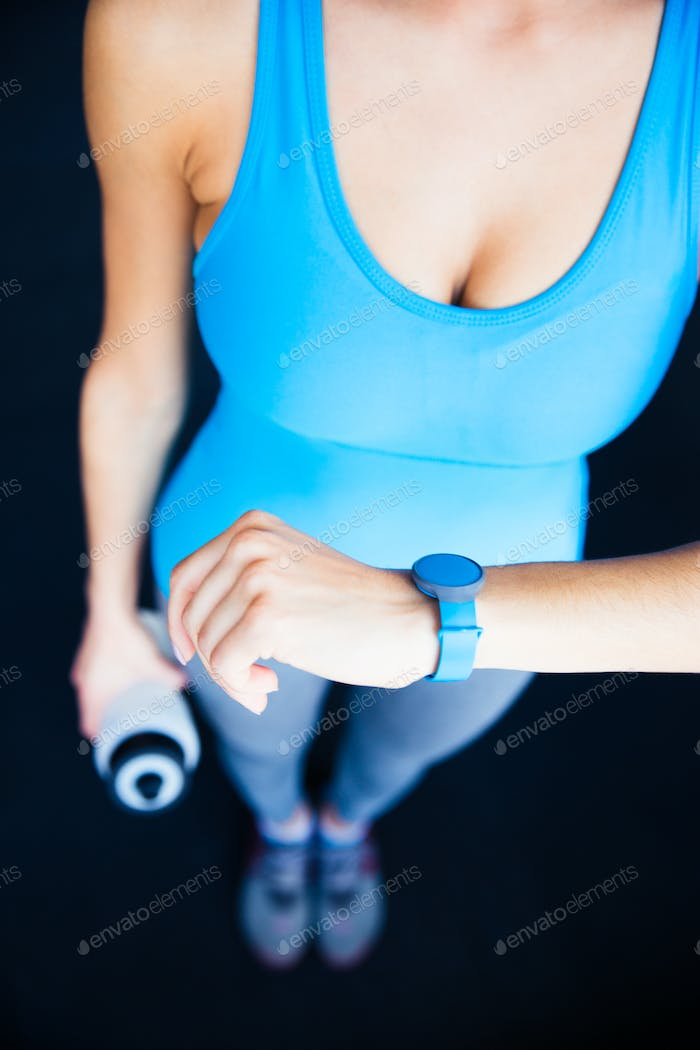 Closeup image of a woman with activity tracker