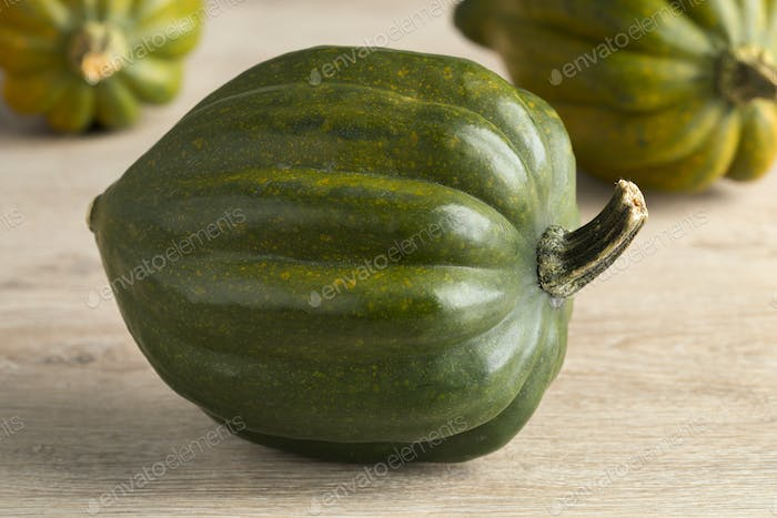 Fresh green acorn squash close up