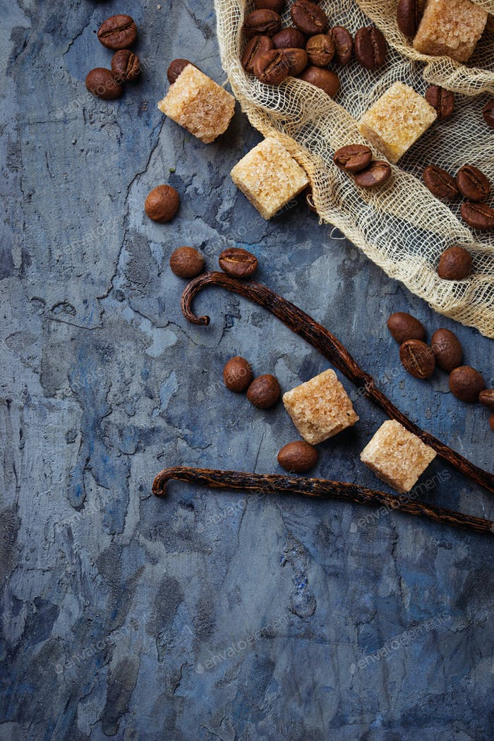 Brown cane sugar, coffee beans and  vanilla pods