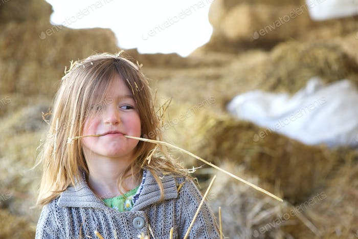 Cute kid with straw in mouth