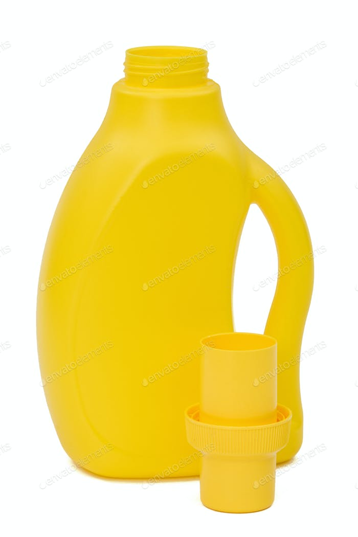 Yellow plastic bottle with a dispenser in cap, isolated on white