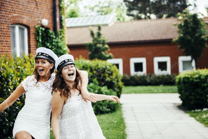 Cheerful female students screaming at graduation party