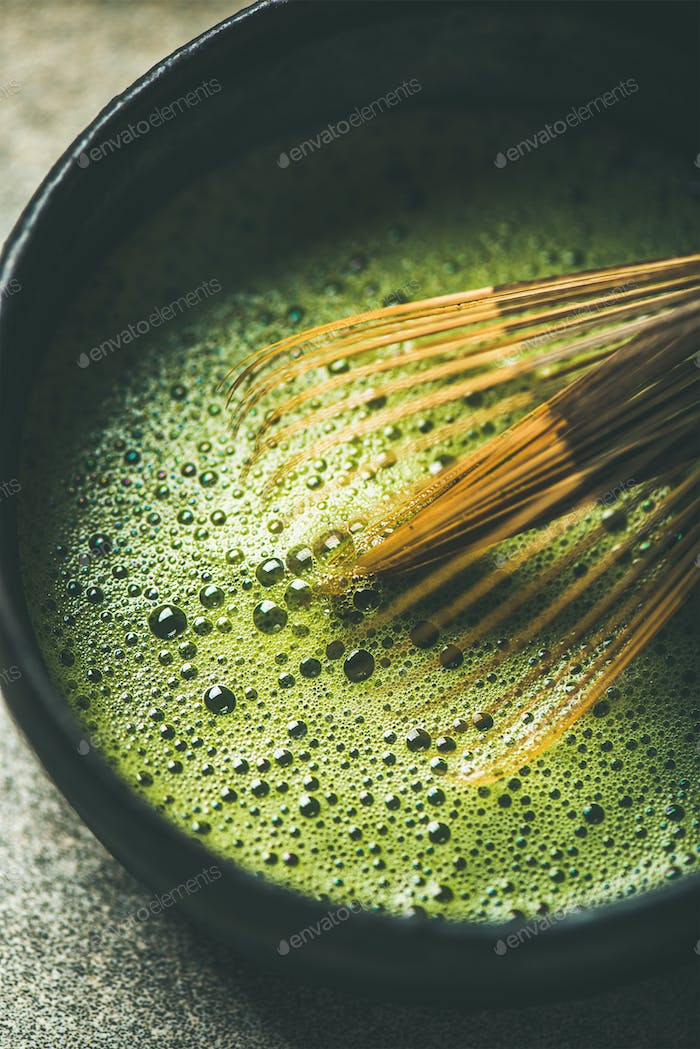 Flat-lay of freshly brewed Japanese matcha green tea, vertical composition