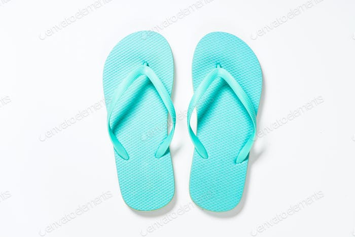 Blue flip flops on white background