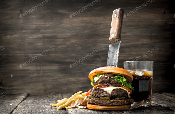 Big burger with cola and fries.