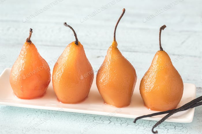 Poached pears on the plate
