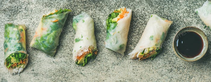 Vegan spring rice paper rolls with chopsticks, wide composition