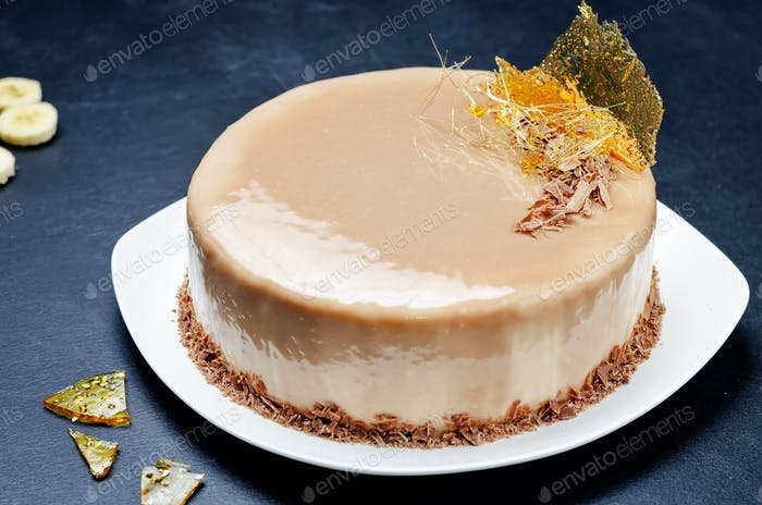 Banana caramel mousse cake with milk chocolate glaze