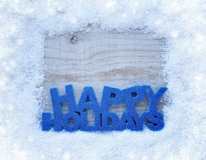 "The frame of the snow and the inscription ""Happy Holidays"" on a"