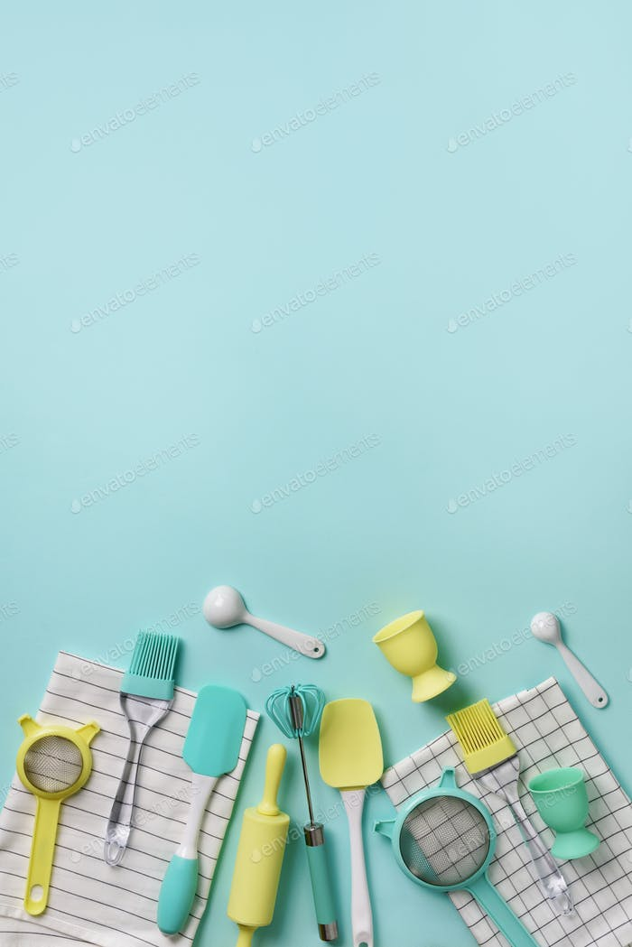 Pastel yellow, blue cooking utensils on turquoise background. Food ingredients. Cooking cakes and