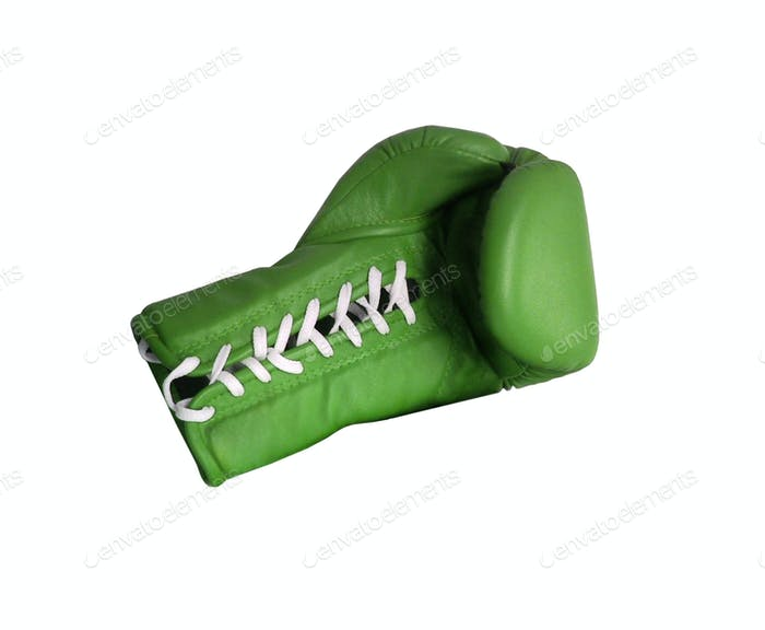Green boxing glove on a white background close up