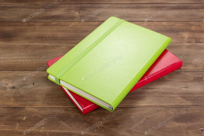 notebook or book at wooden table
