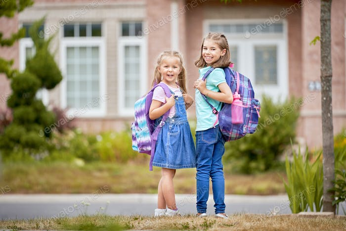 Girls with backpack is going to school