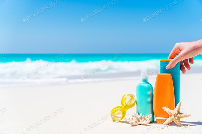 suntan lotion bottles and starfish at the beach