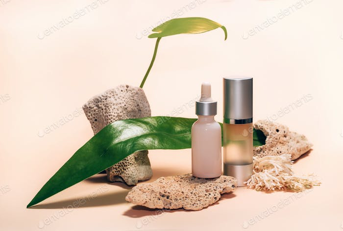 Decorative composition with cosmetics, woman beauty products, corals and leaves