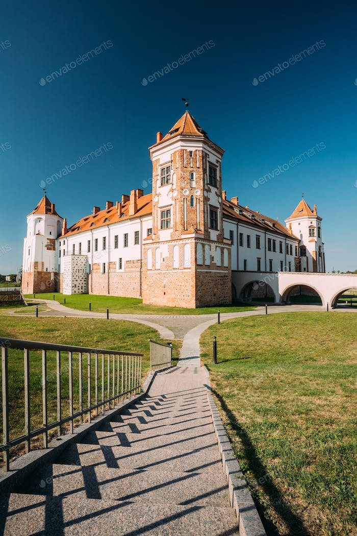Mir, Belarus. Towers Of Mir Castle Complex On Blue Sunny Sky Bac