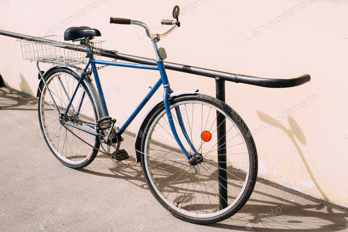 Old Rarity Bicycle Parked Next To Wall