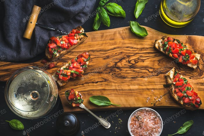 Tomato and basil bruschetta with glass of white wine