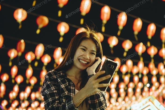 Woman taking selfie at lantern festval