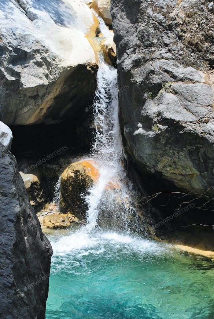 Waterfall among stones
