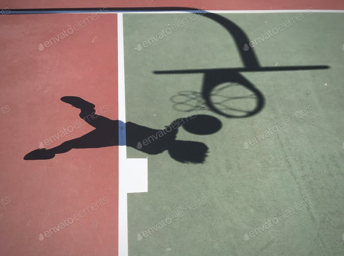 Shadow of Boy Jumping to Play Basketball