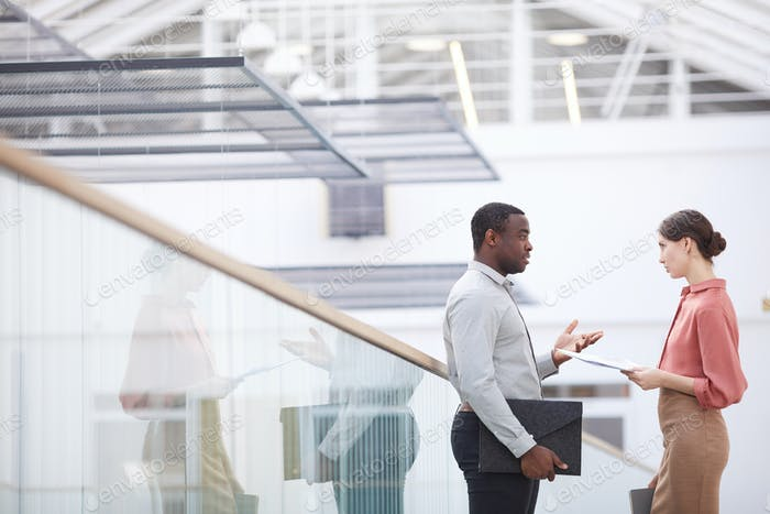 African-American Businessman Talking to Colleague Side View