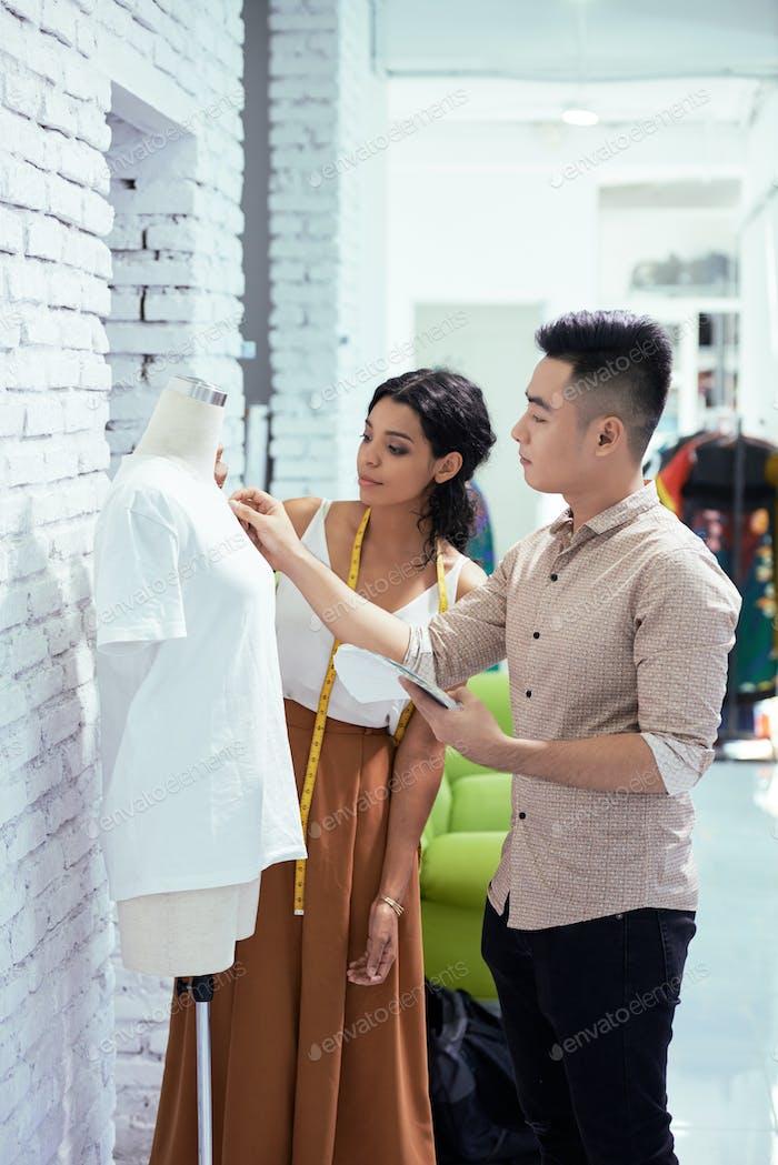 Designers creating a fashion shirt