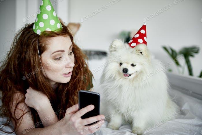 Woman showing her dog a taken selfie