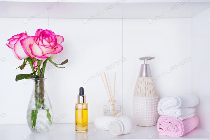 Spa settings with roses. Fresh roses and rose petals and various items used in spa treatments for