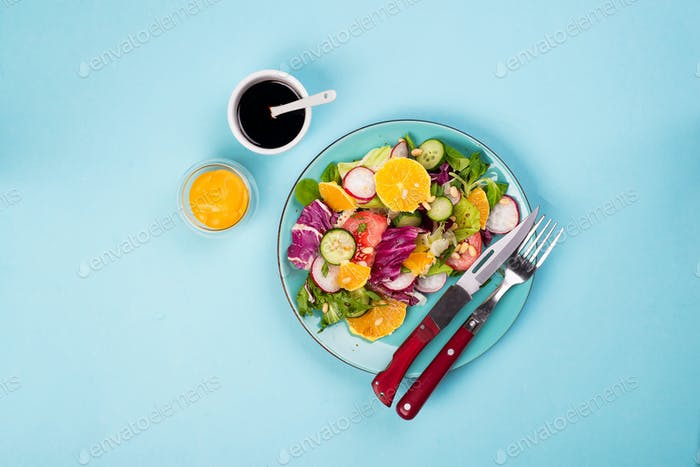 Diet vegetables salad. Fresh mixed falling into a plate