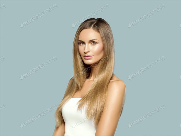 Beautiful woman long hair blonde natural portrait with beauty makeup. On gray.