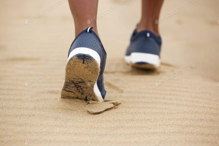 female gym shoes walking in sand