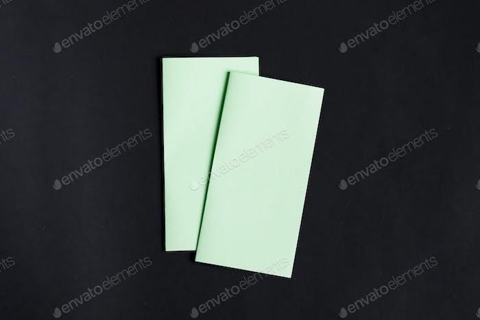 Mockup template paper brochures on a black background